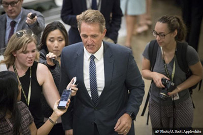 Flake Flakes Over Trump's Divisiveness